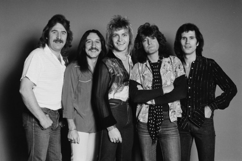 LONDON - 1st DECEMBER: Uriah Heep posed together in Islington, London in December 1981. Left to Right: Lee Kerslake, Mick Box, John Sinclair, Trevor Bolder, Peter Goalby. (Photo by Fin Costello/Redferns)